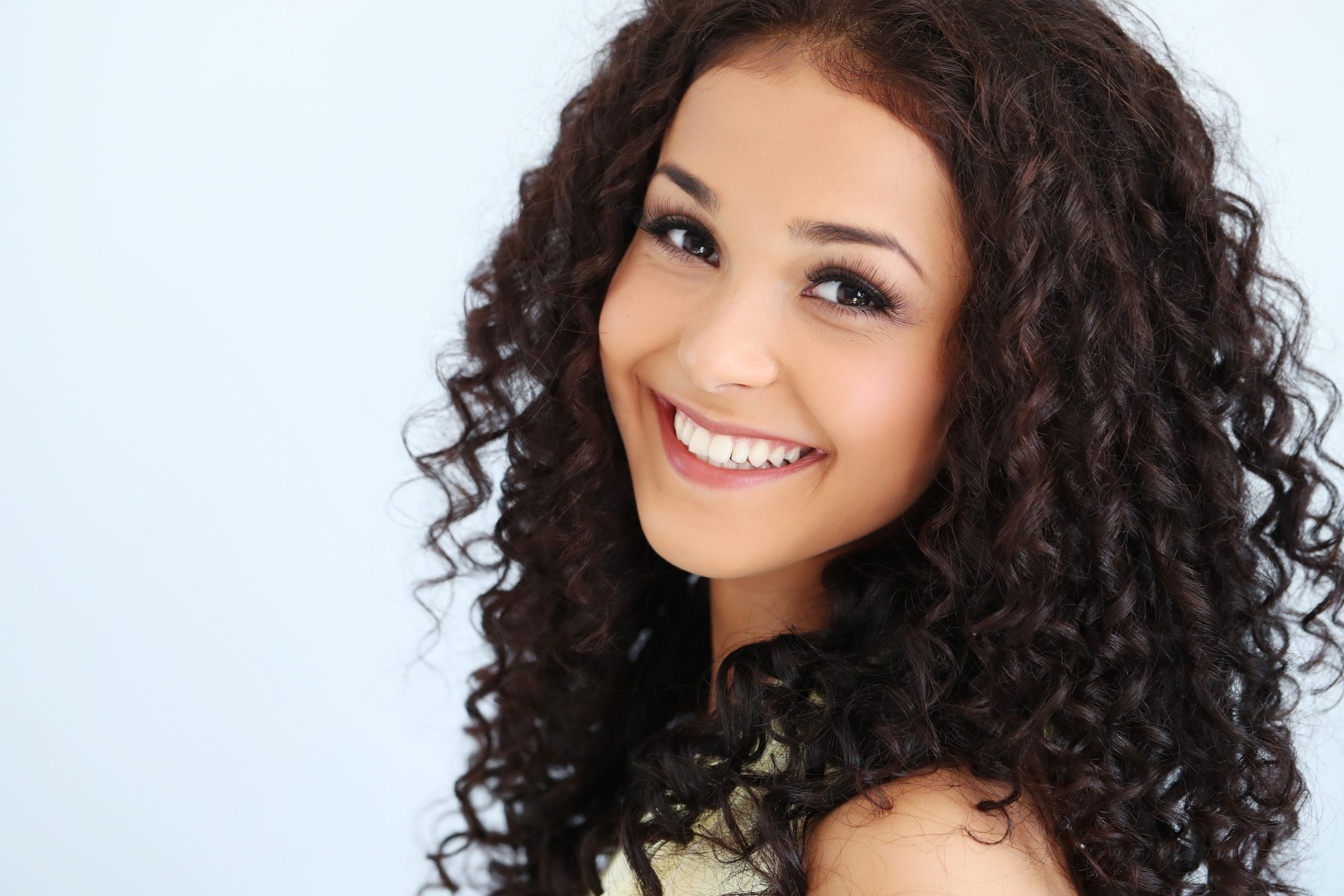 Venezuelan charming woman with curly hair